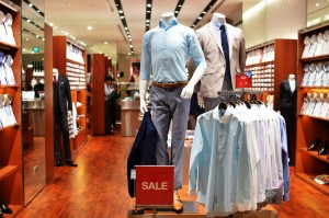 An office wear fashion store with two mannequin displaying the latest trend