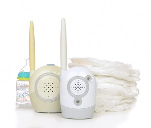 Child baby kid radio monitor device stack of diapers with baby feeding bottle water isolated on a white background